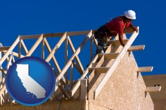 california map icon and a carpenter building a house, working on roof joists