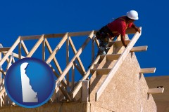delaware map icon and a carpenter building a house, working on roof joists