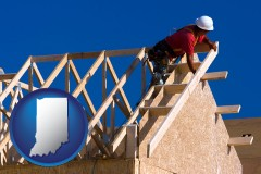 indiana map icon and a carpenter building a house, working on roof joists