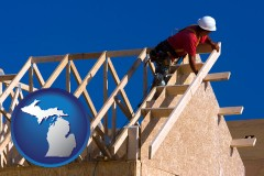michigan map icon and a carpenter building a house, working on roof joists