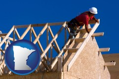 minnesota map icon and a carpenter building a house, working on roof joists