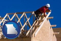 missouri map icon and a carpenter building a house, working on roof joists