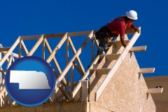 nebraska map icon and a carpenter building a house, working on roof joists