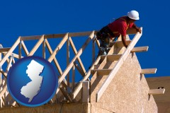 new-jersey map icon and a carpenter building a house, working on roof joists
