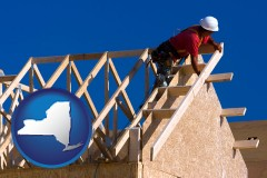 new-york map icon and a carpenter building a house, working on roof joists