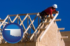 oklahoma map icon and a carpenter building a house, working on roof joists