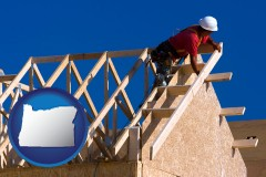 oregon map icon and a carpenter building a house, working on roof joists