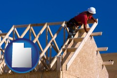 utah map icon and a carpenter building a house, working on roof joists