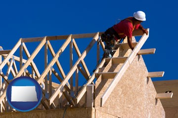 a carpenter building a house, working on roof joists - with North Dakota icon