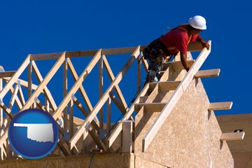 a carpenter building a house, working on roof joists - with Oklahoma icon